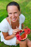 Smiley woman with cocktail in watermelon Stock Photography
