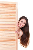 Smiley woman concealed by fitting screen Royalty Free Stock Images