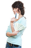 Smiley woman with credit card and cash. Studio picture of smiley woman with credit card and cash over white background Royalty Free Stock Images