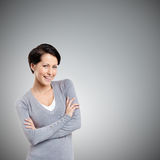 Smiley woman with crossed arms Royalty Free Stock Images