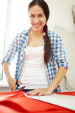 Smiley woman cutting Royalty Free Stock Images