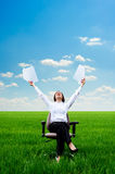Smiley woman with documents at the meadow Royalty Free Stock Photos