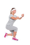 Smiley woman doing aerobics Stock Photo
