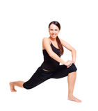 Smiley woman doing flexibility exercises. Isolated on white Royalty Free Stock Image