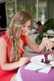 Smiley woman eating tasty dessert Stock Images