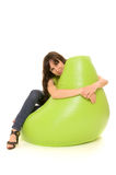 Smiley woman embrace chair. Smiley woman sitting and embrace chair Royalty Free Stock Photo