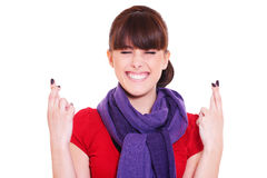 Smiley woman with fingers crossed Stock Photo