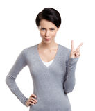 Smiley woman gestures peace sign Royalty Free Stock Photos