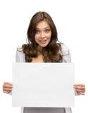 Smiley woman handing copyspace Stock Photos