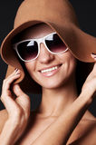 Smiley woman in hat and sunglasses Stock Image