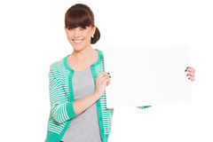 Smiley woman holding empty blank Royalty Free Stock Photography