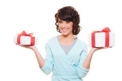 Smiley woman holding gift boxes Royalty Free Stock Photo