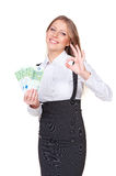 Smiley woman holding paper money Royalty Free Stock Images