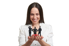 Smiley woman holding three men Royalty Free Stock Photography