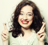 Smiley woman hoping hard with fingers Royalty Free Stock Images