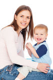 Smiley woman and joyous baby Royalty Free Stock Images