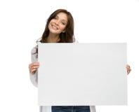 Smiley woman keeping copyspace Stock Photos
