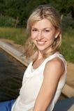 Smiley woman on a lake Stock Photo