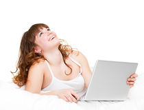Smiley woman with laptop Stock Images