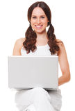 Smiley woman with laptop Royalty Free Stock Image