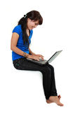 Smiley woman with laptop sitting. Royalty Free Stock Photos