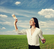 Smiley woman looking at banknote Royalty Free Stock Photography