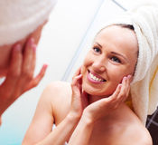 Smiley woman looking at mirror after shower Stock Photos