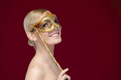 Smiley woman with masquerade mask Royalty Free Stock Photo