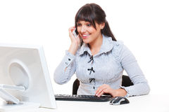 Smiley woman in office talking on the phone Royalty Free Stock Photo