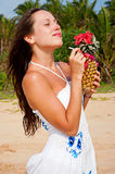 Smiley woman with pineapple Stock Image