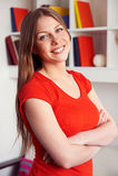 Woman posing over bookshelf Royalty Free Stock Image