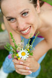 Smiley woman with posy. Portrait of smiley woman with posy Stock Photography