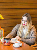 Smiley woman pouring the cup of tea. shot in the cafe royalty free stock images