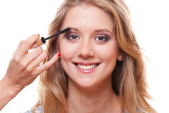 Smiley woman with professional make-up Royalty Free Stock Photography