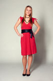 Smiley woman in red dress Royalty Free Stock Photos