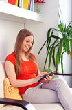 Woman holding tablet pc Royalty Free Stock Photos