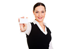 Smiley woman showing businesscard Royalty Free Stock Photos