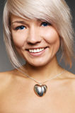 Smiley woman with silver heart Stock Images