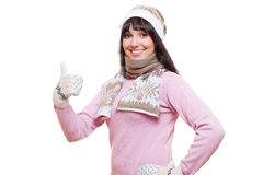 Smiley woman in sweater showing thumbs up Stock Photography