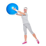 Smiley woman training with ball Stock Photography