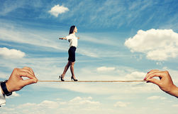 Smiley woman walking on the rope Stock Photos