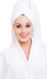 Smiley woman in white bathrobe Stock Image