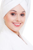 Smiley woman in white bathrobe Stock Photo