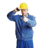 Smiley workman pointing Stock Photography