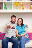 Couple watching TV and resting Royalty Free Stock Photo