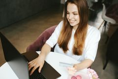 Smiley girl typing on laptop keyboard stock photos