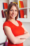 Smiley young woman with folded hands Royalty Free Stock Photo