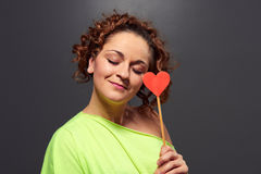 Smiley young woman with heart Stock Photography