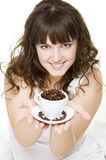 Smiley Young Woman Holding Cup Of Coffee Beans Royalty Free Stock Photo