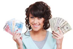 Smiley Young Woman Holding Dollars And Euro Royalty Free Stock Photography